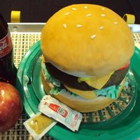 Cheeseburger Cheeseburger is the cake (everything else just props), 3 layer cake, all buttercream and chocolate cake. Covered in fondant. Thanks for...