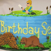 Pond Birthday Cake Cake for my son, he kept changing his theme, finally decided pond. I made a royal icing transfer to resemble him in his kayak. Also ri...