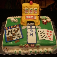 Grandma's Gambling Cake Fondant cake topped with fondant, gum paste, and krispie treats covered in fondant. Features a bingo card, poker chips, dice, cards, and a...