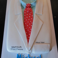 White Coat Celebration Cake For A Pharmacy Graduation Two Layer 9 X 13 Cake With Buttercream Frosting And Marshmallow Fondant White Coat celebration cake for a Pharmacy graduation. Two layer 9 x 13 cake with buttercream frosting and marshmallow fondant.