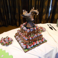 "Deer Grooms Cake 8 & 11"" square rice treat covered in modeling chocolate deer topper. Thanks for looking"
