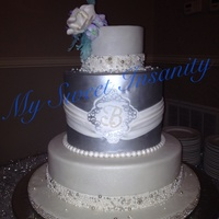"14 10 Double And 6 Covered In Fondant And Pearl And Sugar Encrusted Borders Middle Tier Is Silver With Monogramed Medalian Gumpaste 14, 10 double, and 6"". covered in fondant and pearl and sugar encrusted borders. Middle tier is silver with monogramed medalian...."