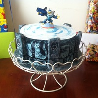 Skylanders Portal Of Power - Light Up Birthday Cake Skylanders Portal of Power. Vanilla sponge with 'sprinkles' for colour.Top cake has a circular hole removed. I used a solar...