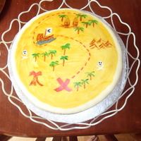 Pirate Party Cake Sponge cake, with fondant icing.I decorated this by painting the icing with sponges and paintbrushes and my food colouring.I copied a...