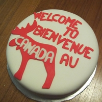 Welcome To Canada A coworker became a Canadian citizen. Cake is a red tomato soup cake with a white cream cheese icing
