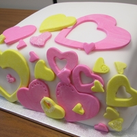 Pink And Yellow Heart Cake A bridal shower cake. Hearts are made from gumpaste. The cake on the inside was alternating layers of pink and yellow in a pina colada...