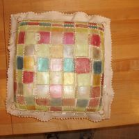 Quilted Pillow Cake coconut cream cake, covered with fondant and hand panted and piped.