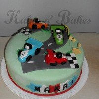 Speeding For 2 car cake for a 2 year old. 12in fondant cake.