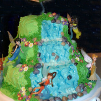 Tinkerbell And Friends I tried to make a waterfall cake like some of the others I had seen here, but it wasn't really cooperating with me. The cake is...