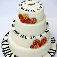 Clock / Time Wedding Cake *The theme of this wedding was time. The cake was inspired by the groom's pocket watch.