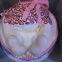 Pink Leopard Baby Rump The nursery theme was pink leopard for this little baby girl. Rump and base are cake, legs and feet are rice cereal treat, fondant accents...