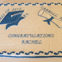 Graduation 2012 Cake Full sheet cake decorated in school colors. Half white / half chocolate with BC icing.