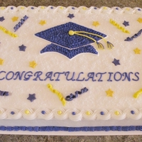 Graduation Cake Cake is a white half sheet cake with BC icing. Confetti and stars are made of fondant.