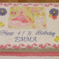 Barbie Birthday Cake Cake is a chocolate 1/4 sheet. Flowers and butterflies are made of RI and fondant. Edible image is of Barbie and her dog. Sugar crystals on...
