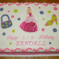 Barbie Birthday Cake Cake is a white half sheet cake with BC icing. Barbie is an edible image and the purse, high heel and flowers are made of fondant.