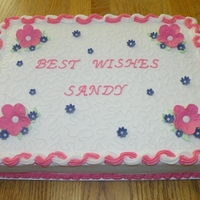Best Wishes Cake This was a half sheet cake. Chocolate and white with BC icing and fondant flowers.