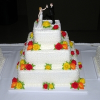 Rose & Calla Lily Wedding Cake Wedding cake for 200 people. Flavors of cake were white, chocolate and strawberry. BC icing with fondant roses and calla lilies.