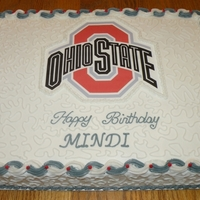Ohio State University Birthday Cake Half sheet cake (white and chocolate) with BC icing. Ohio State logo is an edible image. Cornelli lace on the top and sides to add a little...