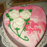 First 2 Cakes These are my first 2 cakes after 4 weeks of class..Heart is chocolate cake with swirled royal icing ..I experimented with the roses
