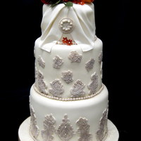 Antique Lace Tiered cake done for a bride whose dress was cream with mocha colored lace. Gumpaste flowers. TFL