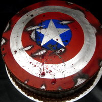Captain America Shield Cake Chocolate with chocolate fudge frosting and modeling chocolate shield on top. Hand painted. TFL
