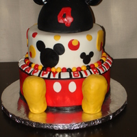 Mickey Mouse I made this for my nephews birthday!! Chocolate cake, chocolate buttercream, covered in fondant, shoes are rkt covered in fondant, and the...