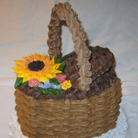 Summer Sunflower Basket   Basket weave cake with royal icing flowers and handle.