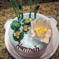 Pond Scene Cake (Hannah's Birthday) May 2011: Choc cake with strawberry-cream cheese filling with MMF base and fondant frog, bees, flora, and gumpaste Water Lilly.