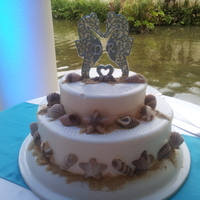Sea Of Love For a destination Wedding - they made the cake, I did the decorations. Royal Icing Seahorses, Chocolate shells, graham cracker sand....