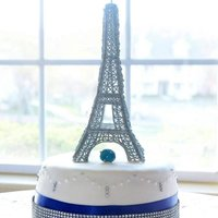 Parisian Bling - Eiffel Tower Cake  *For a couple who got engaged in the Eiffel Tower with a blue diamond ring. Chocolate fudge cake with chocolate fudge filling.Royal Icing...