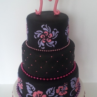 Black, Pink, Purple Hibiscus 35th birthday cake. I made my own stencil and used over-piping brush embroidery technique. My second three tier cake! Bottom tier is a...