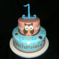 Whoo's Turning 1 First Birthday cake. I made this to match party decor. :) Thanks for checking it out!! Comments welcome :)