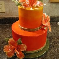 Tropical Sunrise 10 inch bottom three tiers; 6 inch top three tiers; white buttercream, then air brushed from top down using yellow, orange, and red colors...