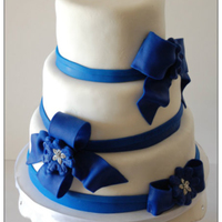"3 Tier Wedding Cake With Deep Blue Fondant Bows And Bling 3 tier wedding cake with deep blue fondant bows and ""bling"""