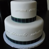 "Celtic Wedding Wedding cake for a couple having a scottish themed wedding. Script on cake reads ""Soul mate"" and ""love loyalty friendship&..."