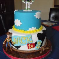 Toy Story Toy Story themed cake I made for my son. Buzz and Woody are toys, the rest is fondant.