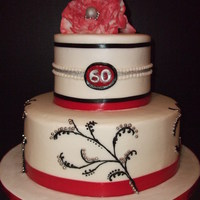 60Th Birthday Buttercream frosting, gumpaste fantasy flower, real ribbon, buttercream vines with silver dragees.