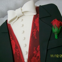 Tuxedo Grooms Cake Carrot Cake with Cream Cheese Icing covered with Fondant. I made this cake for a gentleman in our office who's getting married in a...