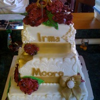 Irma's 80Th Birthday fondant roses, bows and jewels on corners; fondant bow and cameo