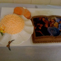 Lady Laura's Cake made for a mother's day luncheon; the purse is a cake covered in orange marblelized fondant; hat is round sphere cake covered in...