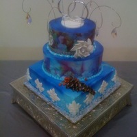 Jo Lynette's Bridal Shower winter wonderland bridal and shower theme; bridesmaids colors were blue; covered in white fondant and spraypainted blue; snowflakes, pine...