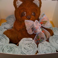 Baby Bear With Cupcakes   Baby bear cake eyes, ears and nose of gel color; rose cupcakes for office shower; ribbon bow matched other shower decor
