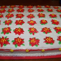 Poinsettia Sheet Cake This is a white sheet cake. The flowers are done in buttercream