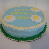 Happy Birthday Omi This a white cake with buttercream filling and decorated all in buttercream. The receiver of the cake LOVES daisies. TFL