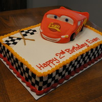 Cars Birthday Cake This is buttercream with fondant accents. Car is white cake instead of RKT. Side checkerboard made with rolled fondant made into squares of...