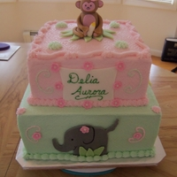 "Girly Jungle Theme 10' chocolate w/chocolate mousse and 8"" yellow w/strawberry filling frosted w/buttercream and decorated with fondant monkey and..."