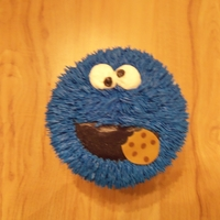"Cookie Monster 6"" Cookie Monster birthday cake. Strawberry cake with chocolate butter cream filling."