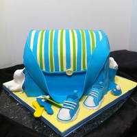 Traveling Baby 2 section cake carved with gum paste accessories