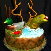 Sportsman Pardise German Chocolate cake. Duck and fish made from RKT antlers were make from gumpaste/fondant mixed