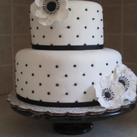 "Black/white Tiered Cake 6"" and 9"" round cakes covered in fondant with ribbon border, frosting dots and gumpaste flowers :) tfl"